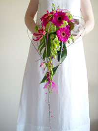 Beach wedding flower bouquet with orchids and gloriosa lilies