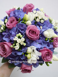 pink roses and blue hydrangea wedding bouquet