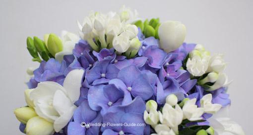 Blue wedding bouquet using hydrangeas and roses