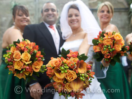 bride and bridesmaids with fall wedding bouquets