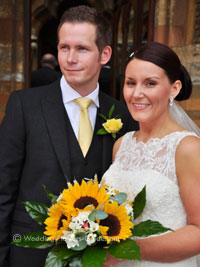 bride holding sunflower wedding bouquet on her wedding day