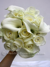 Calla lilies and roses in an ivory bridal bouquet