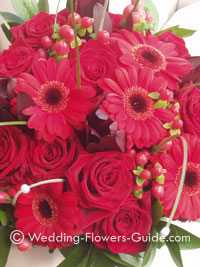 Christmas wedding flowers including gerberas, roses and hypericum berries