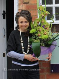 Cindy the wedding florist holding a flower arrangement