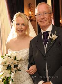 bride with cymbidium orchid wedding flower bouquet