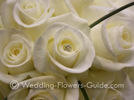 Diamante pins in bridal bouqet of roses