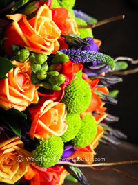 close up of a brides's fall wedding bouquet with roses and lisianthus