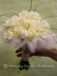 Feathers and rose bridal bouquet