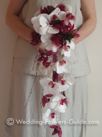 Feathers in shower bouquet with orchids