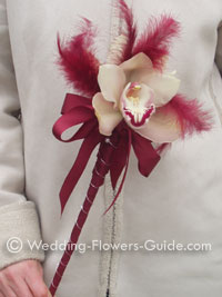 feather wand with cymbidium orchid