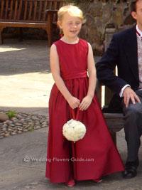 flowergirl holding a white pomander ball