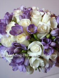 Bride's wedding bouquet of freesias and roses