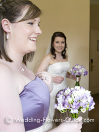 Bridesmaid holding a bouquet of freesia wedding flowers