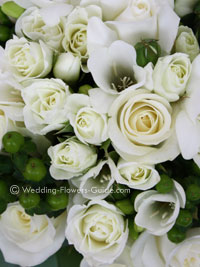 green and ivory white bridesmaid bouquet made with roses and freesias