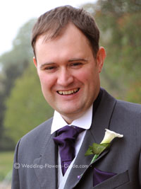groom wearing a calla lily boutonnière