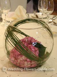 Hydragea wedding flowers arranged in a goldfish bowl