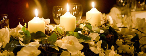 Real wedding flowers - top table arrangement with romantic candles