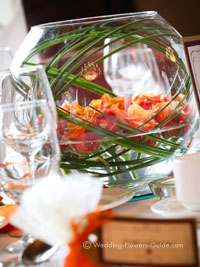 low wedding centerpiece for a fall wedding with orange roses