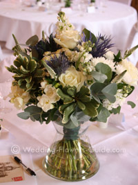 low wedding centerpiece with white and blue flowers