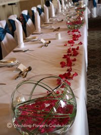 low table arrangements used on a top table at a wedding reception