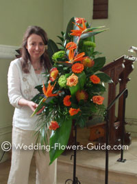 orange church wedding pedestal flowers