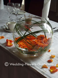 Orange gerberas in a wedding centerpiece for a wedding in October