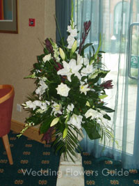 Pedestal wedding ceremony flowers