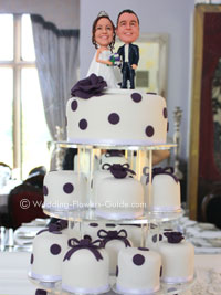 personalized prple and white wedding cake with cake topper