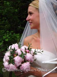 Bride holding pink peony wedding bouquet