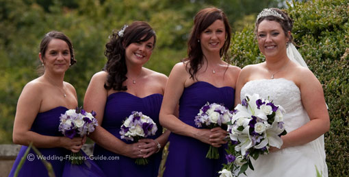 purple bridal bouquets held by bride and bridesmaids