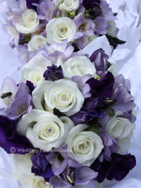 close up of purple, lilac and white wedding bouquets