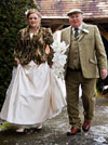 Bride arriving at church with her father, prior to the wedding