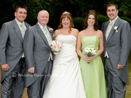 real wedding flowers - bride, groom and and bridesmaid