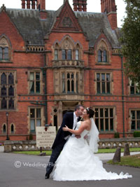bride and groom at a real wedding outside wroxall abbey