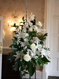 pedestal arrangements used to decorate a wedding recetion