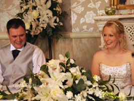 reception wedding flowers at the top table