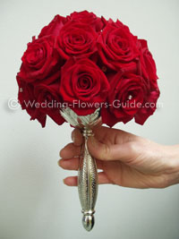 Red rose bridal bouquet with silver handle
