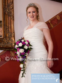 bride with rose cascade bouquet