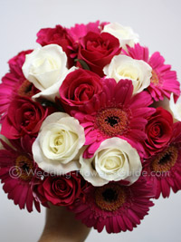 Roses and gerberas in a summer wedding bouquet