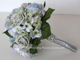 Blue silk wedding flowers created using hydrangeas and roses