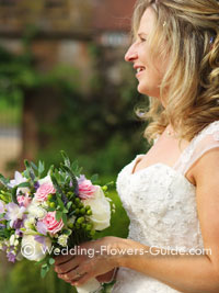 summer vintage bridal bouquet held by beautiful bride