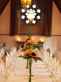 sunflower wedding centerpieces at yellow theme wedding