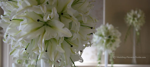 Tall white lily centerpieces