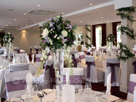 tall purple centerpieces at a wedding venue