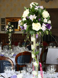 Tall purple and ivory wedding centerpieces