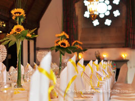 Elegant tall summer wedding centerpieces with sunflowers