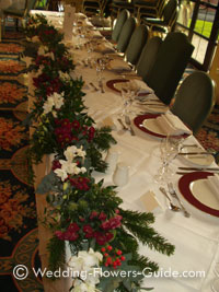 Christmas theme garland used on the top table at a wedding