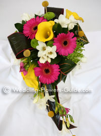 tropical cascade bouquet in pink, yellow and green