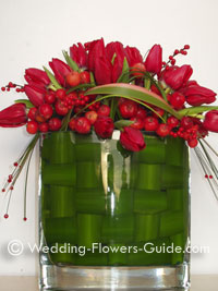 Tulips and crab apples used as christmas wedding flower decoration