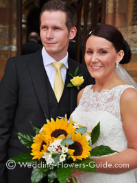 unique sunflower bridal bouquet with bride and groom